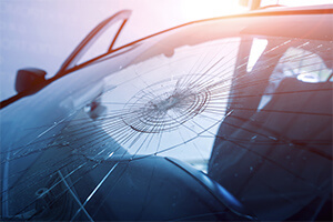A shattered windshield that needs to be replaced by a professional