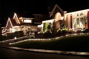 A home nicely decorated with exterior lights for the holidays.